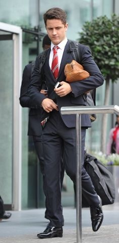 Ander Herrera in a suit travelling to a game.