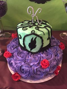 All purple rose frosted cake and fondant covered brownie ball ears.