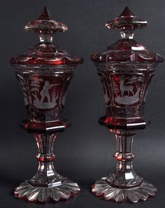 A GOOD PAIR OF BOHEMIAN RUBY GOBLETS AND COVERS etched : Lot 1108
