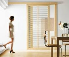 A sleek sliding door is variety of design solutions for modern doors. The Exit Sliding Door Series is a collection of modern doors with wood frames, and glass, wooden or lacquer panel inserts. Wooden Glass Door, Wooden Sliding Doors, Internal Sliding Doors, Sliding Barn Door Hardware, Sliding Glass Door, Glass Doors, Wood Doors, Sliding Room Dividers, Diy Room Divider