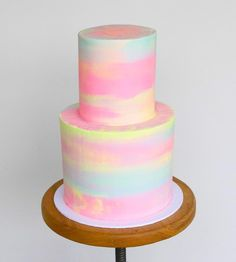 A naked watercolour cake, ready for decorating. I love how this reminds me of the rainbow Paddle Pops from my childhood! This two-tiered beauty is hiding layers of chocolate & vanilla buttercake, filled with salted caramel Swiss meringue buttercream (because we all know 'rainbow' is just caramel flavour masquerading as a unicorn )