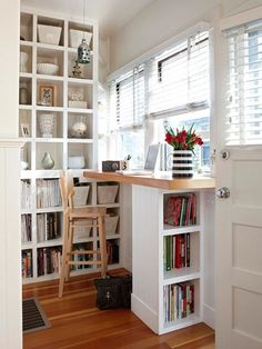Turn that corner beside your door a space for you to get productive. You have the view of the people that can help inspire you with work. The floor to ceiling shelves would also help in organizing books and some decors.
