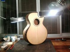 Acoustic by Shane Guitarmaker... like the soundholes