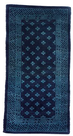 A dark blue ground with stylized flowers in light blue. The main border with a stylized vine. Bukowski, Auction, Blanket, Rugs, Antiques, Crochet, Farmhouse Rugs, Antiquities, Antique