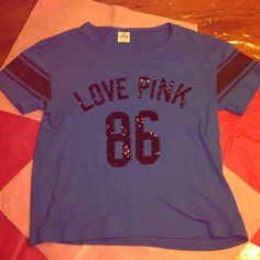 """Vs pink bling varsity top Victoria's Secret pink bling varsity top. Size extra small. Blue in color. Says """"Love pink 86"""" on the front in black sequins. This top is preowned with minor flaws....some of the sequins are out of place but other than that it's still in great condition! PINK Victoria's Secret Tops Tees - Short Sleeve"""