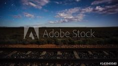 Stock Footage of Linear timelapse at night time with a dramatic moonlit landscape scene in the Karoo with railway lines and scattered clouds available on request. Explore similar videos at Adobe Stock Milky Way, Windmill, Stock Video, Geology, Night Time, Stock Footage, South Africa, Adobe, Southern