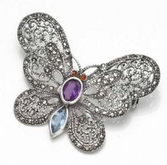 Curvacious Sterling Silver with Marcasite & Semi-precious stone detail. So beautiful