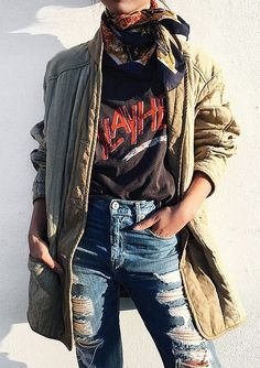 Margaret Zhang layers up her band tee with a cargo coat, boyfriend jeans, and an of-the-moment silk scarf.