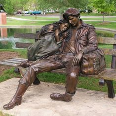 """Departure"", installed in the park near the library in Loveland, CO, is a life size bronze sculpture by the American artist, George Lundeen. According to the artist, ""The original piece came from a sketch I did in the Rome train station. There were a couple of kids across from me on the marble floor. It became the first life-size piece I ever did""."