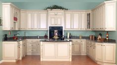 Google Image Result for http://www.kitchen-cabinet-idea.com/wp-content/uploads/2012/04/cream-painted-kitchen-cabinets.jpg