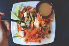 Noodle-free pad thai made with shaved carrots and zucchini, a light tamarind-based dressing, peanut sauce, and fresh tofu. Tofu Pad Thai, Pad Thai Sauce, Baker Recipes, Tofu Recipes, Asian Recipes, Vegetarian Recipes, Healthy Recipes, Zucchini, Spiralizer Recipes
