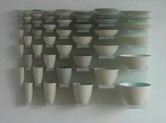 this shows scale and proportion by using the different size bowls within the same composition