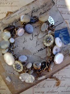 Mother of Pearl Button and Cufflink Vintage Repurposed Bracelet...Unbelievable how much this cost and so easy to make. Items can be purchased at Wal-Mart or most craft stores