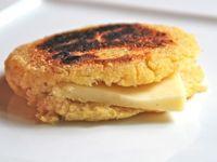 Quinoa Arepas - Arepas de Quinoa are griddle corn cakes made with a specially processed cornmeal called masarepa and Quinoa!