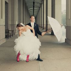 bride and groom wearing rainboots! I mostly love the boots and umbrella!!!!!