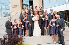 Bridal party in purple and grey on the steps of The Mint Museum Uptown Charlotte, NC | wedding planner: The Graceful Host | flowers: New Creations Flower Company | wedding venue: Mint Museum Uptown | photography: Brent Gullege