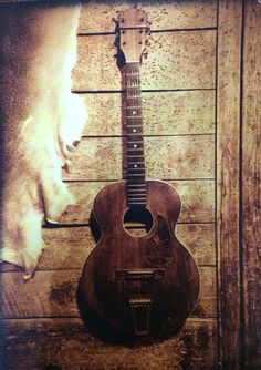 The guitar may hang with no strings, but holds a heart full of memories. #guitar