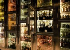 The wall of mini-bars is accessed with a personal key that customers receive after checking in at the door.