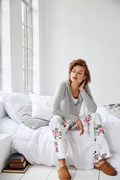 Curl up and get cosy in this season's beautiful, cotton pyjamas in a range of striking winter prints.