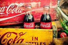 Coca-Cola bottles in old soda crates