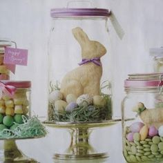 Eggs and grass in mason jars with flowers/chocolate bunnies on top. Also use apothicary jars or Cloches on cake stands.