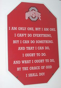 A sign hanging on the wall of the football locker room at the Shoe