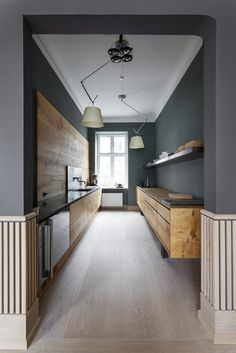 If you are having a sleek and modern theme kitchen in your house, you might need to have some of these best galley kitchen ideas. There are a lot of design ideas you can take as inspiration in this article. House Design, House, Oak Kitchen, Interior Architecture, Upper Kitchen Cabinets, Kitchen Remodel, House Interior, Kitchen Design, Modern Oak Kitchen
