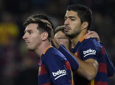 Barcelona's Argentinian forward Lionel Messi (L) celebrates with Barcelona's Uruguayan forward Luis Suarez (R) after scoring during the Spanish league football match FC Barcelona vs Athletic Club Bilbao at the Camp Nou stadium in Barcelona on January 17, 2016.
