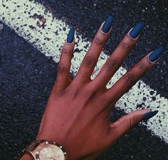matte blue nails. dark skin.
