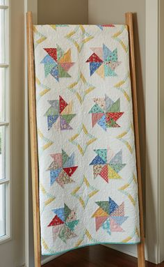 SPINNING PINWHEELS by Wendy Sheppard: Paper foundation piecing makes it easier to assemble blocks with odd angles and unusual shapes. If you haven't tried it yet, go ahead! It's fun, and you'll be pleased with the results. This quilt features 1930s prints arranged in unusual shapes and our pattern includes full-sized patterns. This would make a beautiful wedding or engagement gift for someone you love!