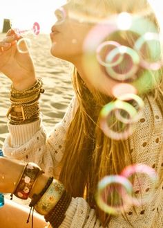 I love this for a senior portrait session in spring or summer. The lighting! The bubbles! :D