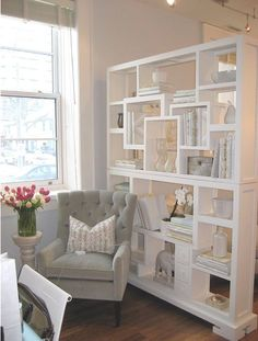 "Airy, yet traditional. Great way to ""divide"" a room and showcase neat pieces…"