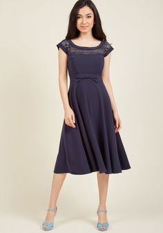<p>If you're going to give your most coquettish expression, you might as well lend it as an accessory to this navy dress! Made stunning from a bateau neckline detailed with geometric lace, a waistline bow, and a swingy midi skirt touched with stretch, this retro darling - a ModCloth exclusive -embodies sophistication with a hint of flirtation.</p>