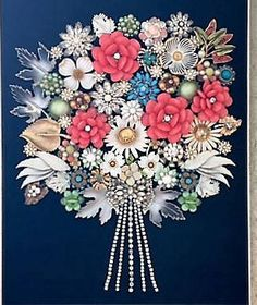 Brighten any room with this multi-colored flower bouquet art made with a mixture of enamel and rhinestone Vintage Costume Jewelry on black velvet in a newframe measuring approx. 14x17 with an opening approx. 11x14. The frame is a muted gold with some silver in it, that makes it the perfect compliment to any room. Note: Because this is handmade and using vintage costume jewelry, there may be small imperfections or signs of use in some jewelry, but I feel this just adds to the beauty of the…