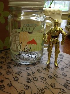 C-3PO is helping us celebrate Star Wars Day down at the shop. Stop by and take a look at our new Mason jar mugs for yourself!  In the meantime 3PO will be enjoying his. May the Fourth be with you!
