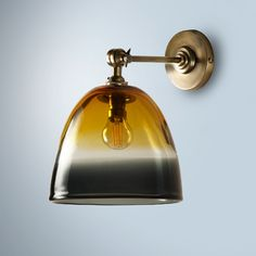 Petite and elegant, this hand blown light combines colour and grace. Works equally well as a wall light