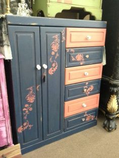 SOLD - This solid wood armoire has been painted and stenciled into colors. The double doors open to reveal shelves as well as a shoe rack. Shelves could be removed to create a hanging area. The cabinet has six smooth pulling drawers. It measures 44 inches across the front, 17 inches deep and it stands 55 inches tall. It can be seen in booth D 8 Main Street Antique Mall 7260 East Main St ( E of Power Rd ) Mesa 85207  (contact info hidden) open 7 days 10 till 530  Cash or charge ...