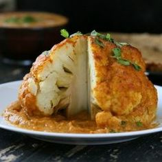 Whole Roasted Cauliflower drenched in creamy Makhani Gravy