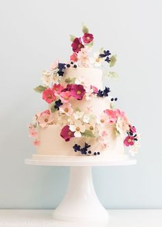 Featured Cake: Rosalind Miller Cakes; Adorable pink and white flower covered white wedding cake