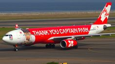 AirAsia X (MY) Historic fleet, Airbus A330-343 9M-XXO aircraft, painted in ''Thank You Captain Park'' special colours Jan. 2014, skating at Japan Nagoya Chubu Centrair International Airport. 03/05/2014. (Captain Park=a playland in Malaysia).
