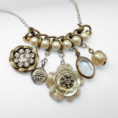 Pretty vintage-inspired necklace made from reclaimed gold and silver chain, pearls, and nostalgic baubles and trinkets