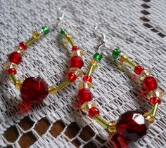These dazzling earrings are handmade with Green and Yellow Glass beads and Bright Red Acrylic Beads in a stylish Hoop Design! Connected with fish/french hook wire
