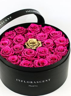 Glitz & Glam Arrangement! Real Roses that last a year created in luxurious Parisian style handcrafted boxes! Roses in a box!