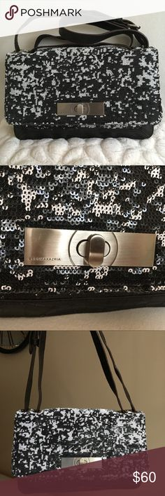 "BCBGMAXAZRIA Sequin/Leather Crossbody/Shoulder Bag BCBGMAXAZRIA sequined leather crossbody / shoulder bag. Color : dark brown. Shell : 70% leather, 30% acrylic. Like new, excellent condition, has no visible signs of wear. A beautiful shoulder bag that can be worn crossbody too. The strap is adjustable. The shortened is about 12.5"", the longest version - 22.5"". Measurements: 11"" L x 7"" H x 4"" W. Has a very little mark on the back - hardly noticeable ( see last photo). Reasonable offers…"