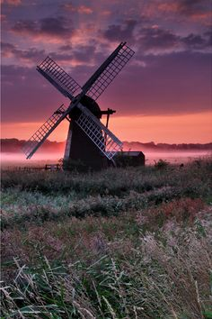 windmill with pink sky and mist, suffolk