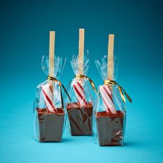 Melt chocolate into molds stick in candy cane then stir in a cup of hot chocolate .