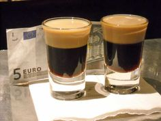 """A cab driver suggested we try a """"Baby Guinness"""", made from a base of Kahlua topped with a floater of Bailey's, served in a shot glass. It looked like a miniature version of a pint of Guinness."""