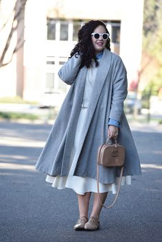 Girl With Curves featuring a grey trapeze coat from Asos, Ruffle Sweater from Asos, White Midi Skirt from Asos, Flats from Sole Society and Chanel Bag.