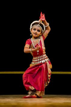 A 4 year old performing Abhinaya in an Odissi dance recital