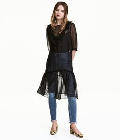 Black. Knee-length, straight-cut dress in sheer woven fabric with a ruffle at top. Opening at back of neck with button, 3/4-length sleeves with buttons at